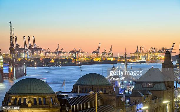 Germany, Hamburg, Port of Hamburg and St. Pauli Landing Stages in the evening