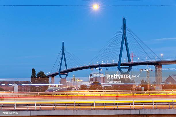 germany, hamburg, port of hamburg, blurred car lights on bridges - köhlbrandbrücke stock photos and pictures