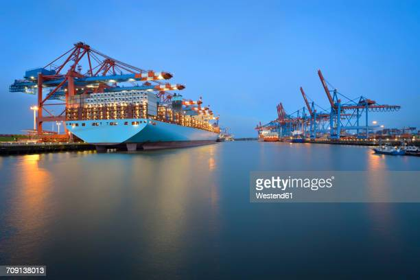 germany, hamburg, port of hamburg, container terminal with ship in the morning - industrial ship stock pictures, royalty-free photos & images