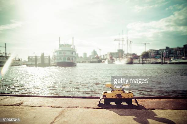 Germany, Hamburg, Port of Hamburg, Elbe river, Bollard against the sun