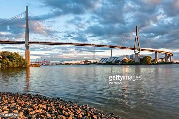 germany, hamburg, port of hamburg, koehlbrand bridge in the evening light - köhlbrandbrücke stock photos and pictures
