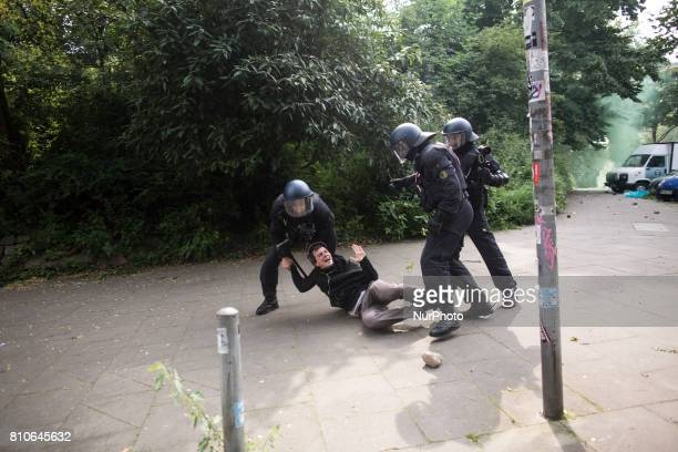 Riot police arrests a demonstrator during protests during the G20 summit in Hamburg Germany on July 7 2017
