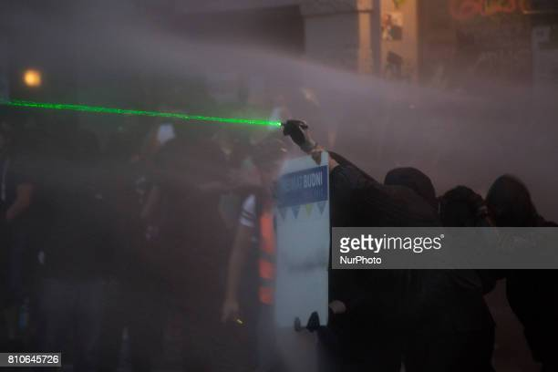 Riot police use water cannons during protests in Hamburg's Schanzenviertel district during the G20 summit in Hamburg Germany on July 7 2017