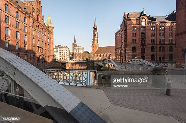 Germany, Hamburg, Speicherstadt in the morning, in the background St. Catherine's Church
