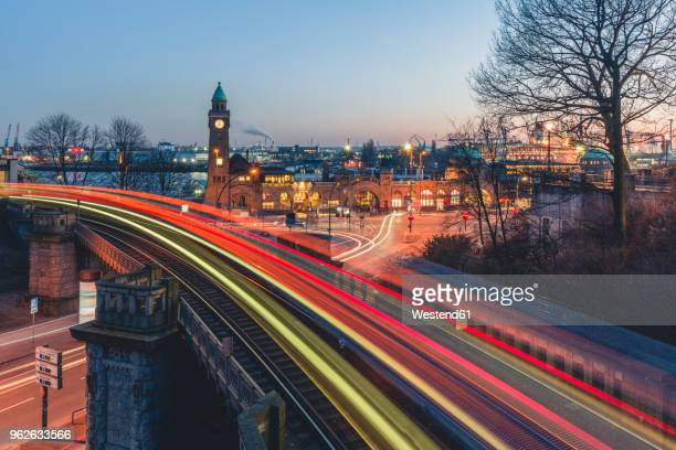 germany, hamburg, st. pauli landing stages, gauge tower, light trails of trains - hamburg germany stock pictures, royalty-free photos & images