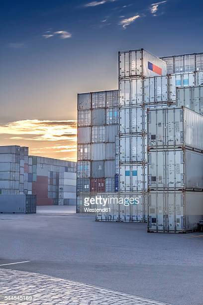 Germany, Hamburg, Stacked shipping containers at harbour