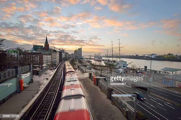 germany, hamburg, sunrise on the harbor edge - passenger train stock pictures, royalty-free photos & images