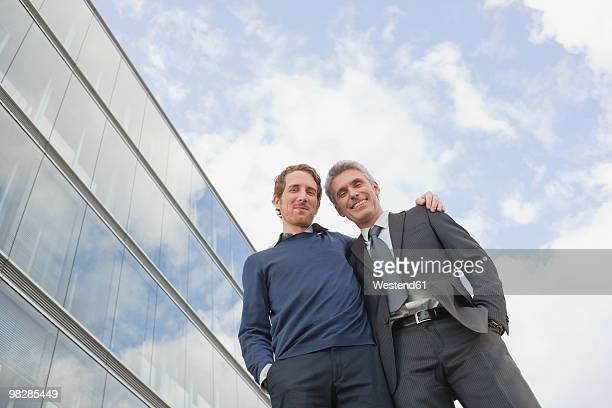 Germany, Hamburg, Businessmen smiling, low angle view