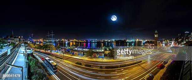 Germany, Hamburg, view to landing stages by night