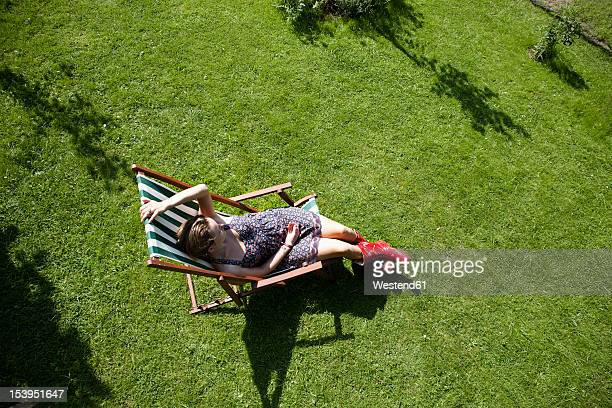 Germany, Hamburg, Woman relaxing in deck chair