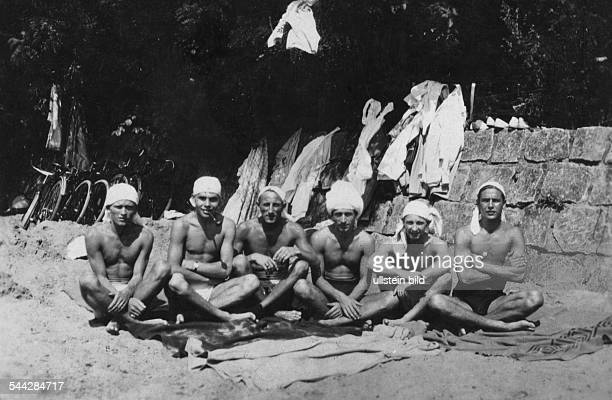 young men relaxing in the sun on the beach of the river Elbe in Oevelgoenne nineteentwenties