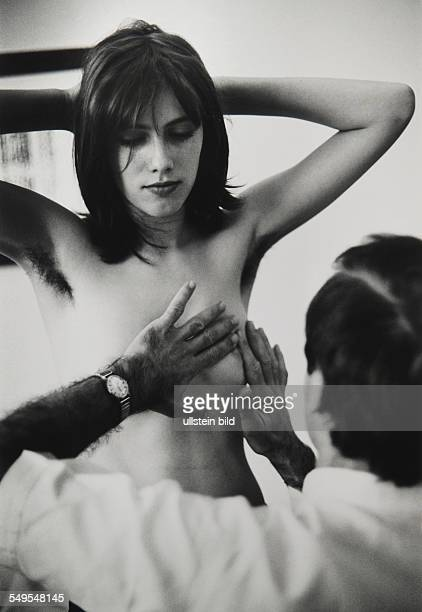 Germany Hamburg young woman getting her breasts examined by the gynaecologist for cancer screening / checkup for cancer