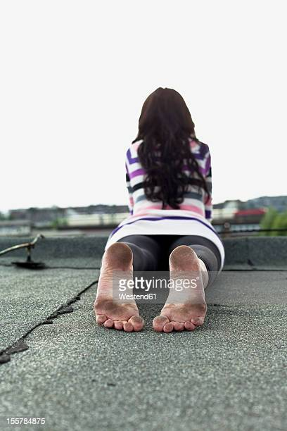 germany, hamburg, young woman lying on roof - dirty feet stock pictures, royalty-free photos & images