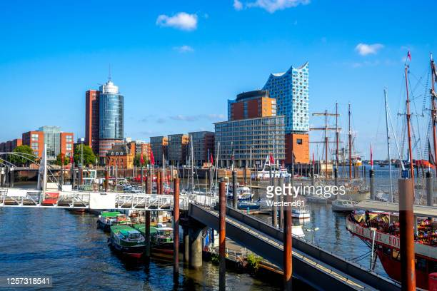 germany, hamburg,hafencity harbor with elbphilharmonie in background - hamburg germany stock pictures, royalty-free photos & images