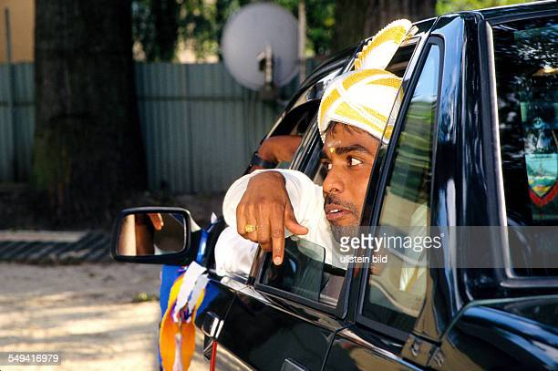 HinduTamils in Germany Wedding the bridegroom and witness of the marriage in their car in front of the Sri Kamadschi Ambal Temple