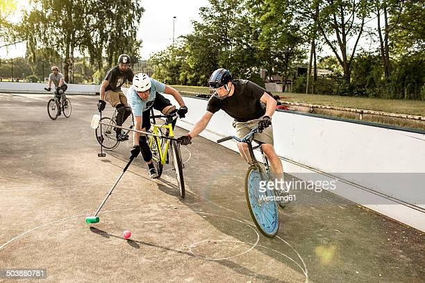 Germany, Hannover, Group of men playing bike polo