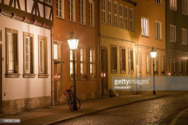Germany, Hannover, Kreuz Street, City street with row of houses at night