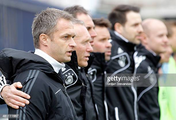 Germany head coach Christian Wuck sings national anthem prior the UEFA Under17 Elite Round between Germany and Ireland at Stadion FC Obilic on March...