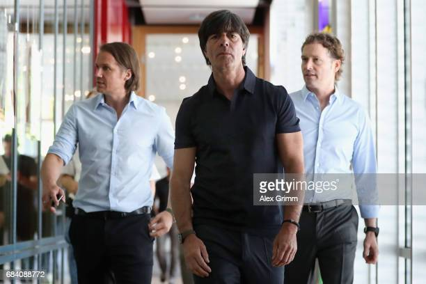 Germany head coach Joachim Loew and assistant coaches Marcus Sorg and Thomas Schneider arrive for a press conference with U21 head coach Stefan Kuntz...