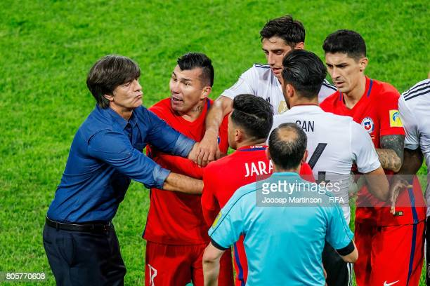 Germany Head Coach / Manager Joachim Loew clashes on the pitch with Gonzalo Jara of Chile during FIFA Confederations Cup Russia final match between...