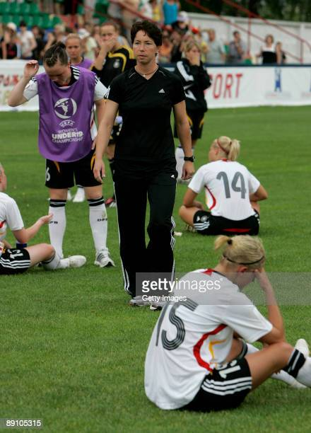 Germany head coach Maren Meinert and players react after the UEFA Women's Under 19 Championship match between Germany and Belarus at the Torpedo...