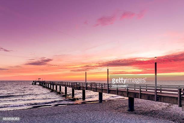 Germany, Heiligendamm, sunrise at pier