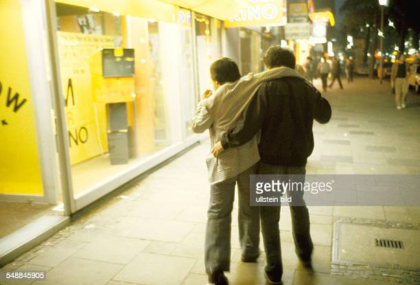 Germany Hesse Frankfurt am Main A drunk man at Frankfurts station quarter 1990