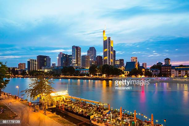 Germany, Hesse, Frankfurt, Financial district and Main river in the evening