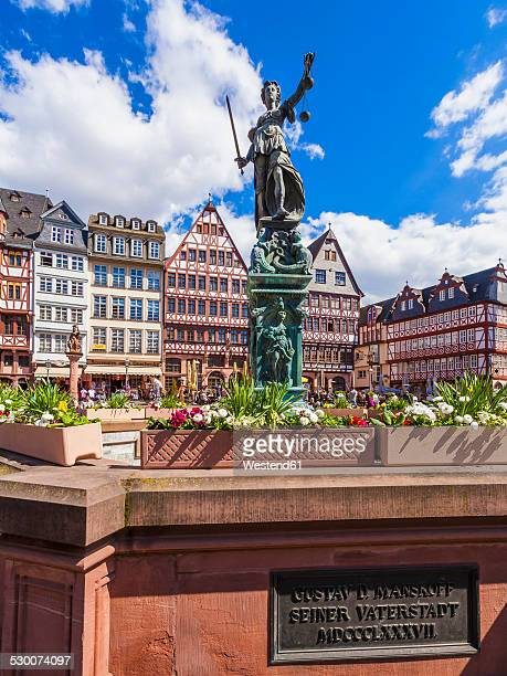 Germany, Hesse, Frankfurt, view to half-timbered houses at Roemerberg with fountain of justice in the foreground