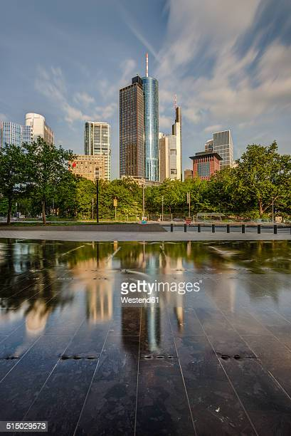 Germany, Hesse, Frankfurt, view to Main Tower with water reflection in the foreground