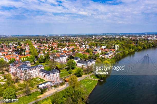 germany, hesse, hanau, helicopter view of town on bank of river main in summer - hanau stock pictures, royalty-free photos & images