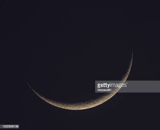 germany, hesse, hochtaunuskreis, new moon crescent with craters - lunar eclipse stock pictures, royalty-free photos & images