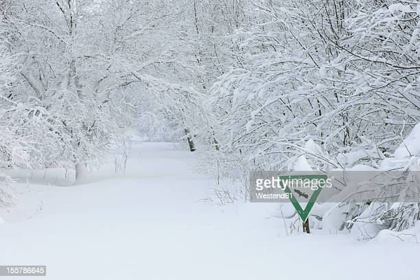 Germany, Hesse, Sign of nature reserve on snowy landscape at Rhoen Mountain
