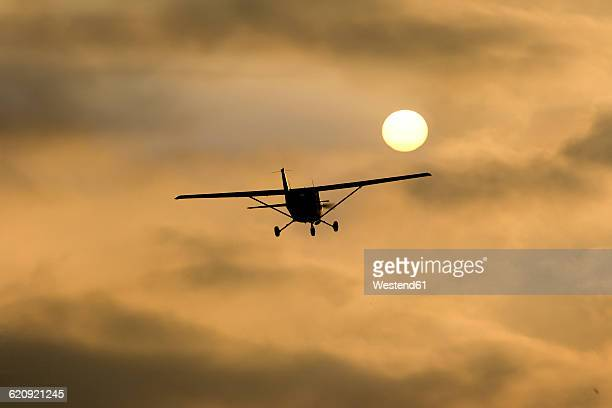 Germany, Hesse, Sports plane Cessna 152 in the evening