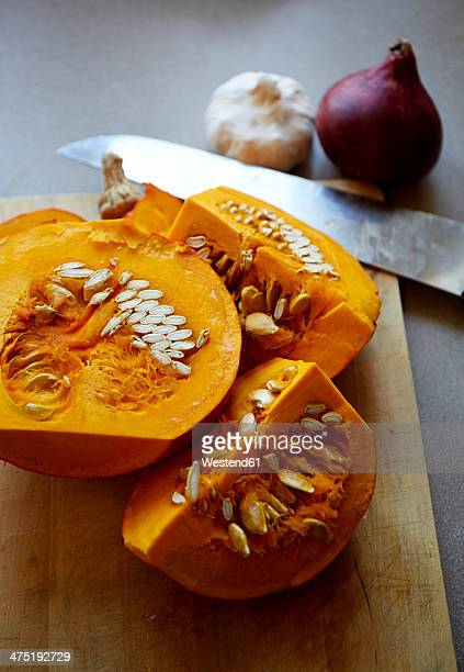 Germany, Hokkaido pumpkin on chopping board
