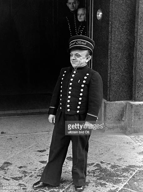 Germany Hotel Central in Berlin the smallest bellboy Enrico Grano Photographer Herbert Hoffmann Published by 'Berliner Morgenpost' Vintage property...