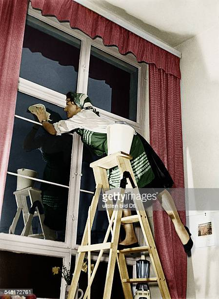 Germany Housewife cleaning her windows Digitally colorized Original image no 00479836 1956