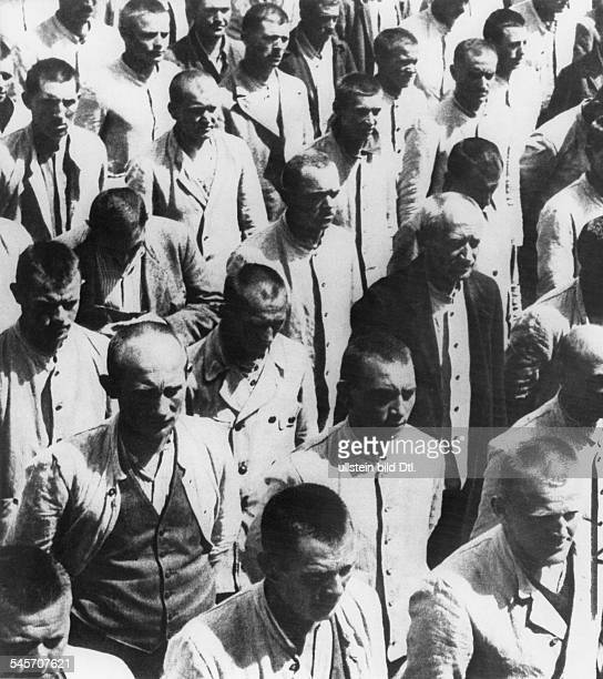 Germany IIIReich persecution of political enemies 193339 First concentration camps Prisoners standing during a rollcall in Dachau concentration...