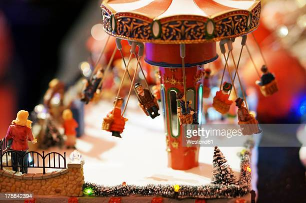 Germany, Illuminated toy roundabout for christmas decoration, close up