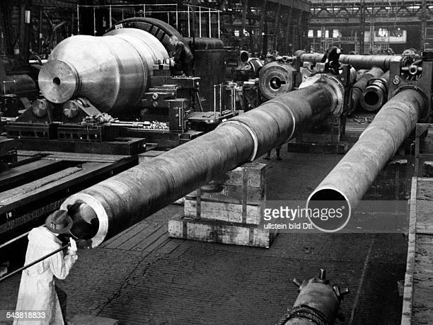 Germany in WWII, Arms industry, close examination of a gun barrel in a German arms factory - Photographer: Hanns Hubmann- published by Signal...