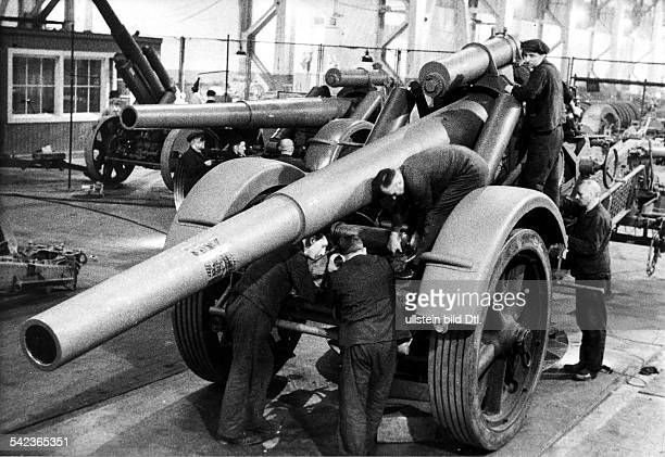 Germany in WWII, Arms industry, final assembly of heavy field guns in an arms factory of the Friedrich Krupp company- Photographer: Hanns Hubmann-...