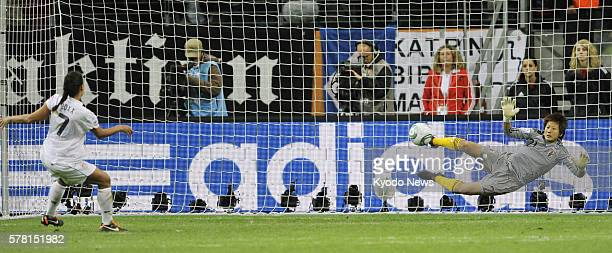 FRANKFURT Germany Japan goalkeeper Ayumi Kaihori blocks a penalty kick from Shannon Boxx of the United States who was the first to shoot the US...