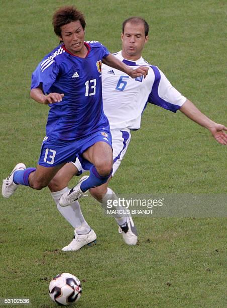 Japanese forward Atsushi Yanagisawa vies with Greek midfielder Angelos Basinas during the 2005 FIFA Confederations Cup football match Japan vs Greece...
