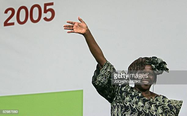 Kenya's Nobel Peace Prize laureate Wangari Maathai waves as she attends with German Chancellor Gerhard Schroeder the 30th Church Day organized by the...