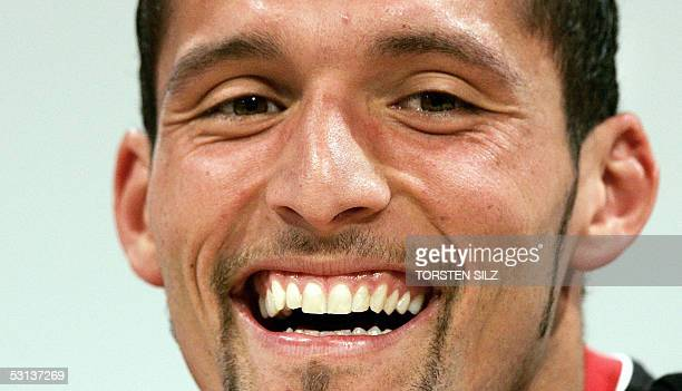 Kevin Kuranyi forward of the German national football team smiles during a press conference 23 June 2005 in Herzogenaurach southern Germany Germany...