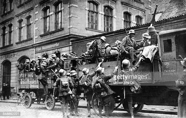 Germany Kingdom Bavaria Munich: Beer Hall Putsch: SA members from the countryside arriving outside the Buergerbraeukeller - 1923 - Photographer:...