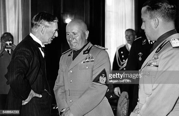 Germany Kingdom Bavaria Munich Munich Agreement the british prime minister Neville Chamberlain talking to the italian head of state Benito Mussolini...