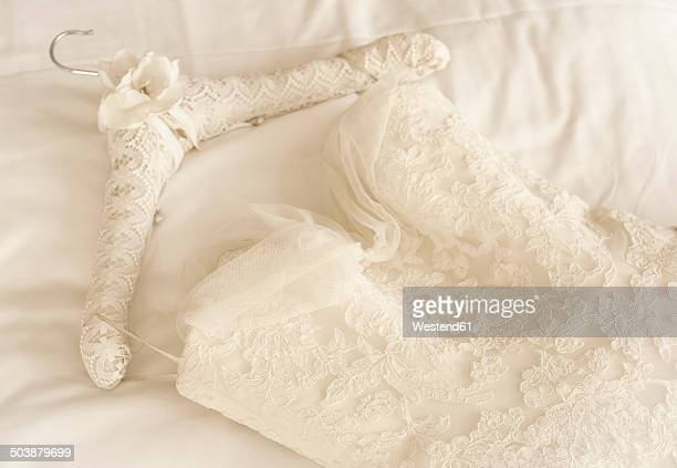 germany, lace wedding dress lying on bed - lace dress stock pictures, royalty-free photos & images