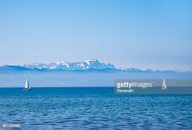Germany, Lake constance, sailing boats, Mountains Altmann and Saentis in Switzerland