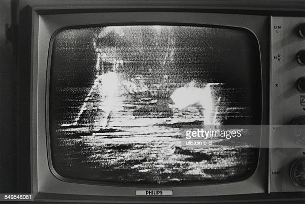 Germany landing on the moon on television screen on the 21st of July 1969 four o clock in the morning